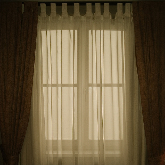Curtain and drape trends are moving away from boring styles, like this setup